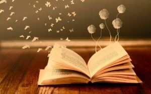 Open book with butterflies and flowers