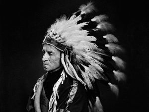 John Buchan in Native American headdress
