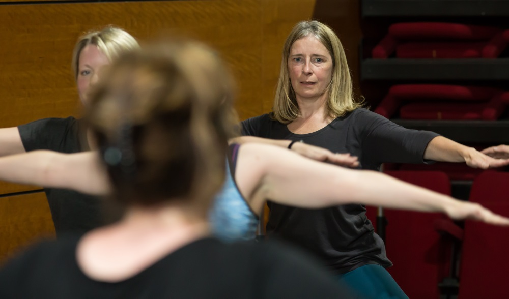Women stretch at a jazz dance class