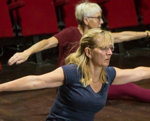 Women stretch at a jazz dance class